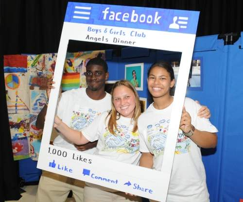 Three students in a Facebook poster frame