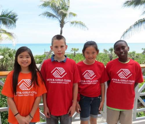 Four BGCIRC students outside in front of palm trees